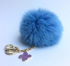 A personal favorite from my Etsy shop https://www.etsy.com/listing/234036163/sky-blue-fur-pompon-bag-charm-pendant
