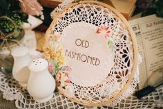 Old fashioned embroidery table decor, from 'A 1920s and 1930s Antique and Old Fashioned Vintage Inspired Barn Wedding'.  Photography http://www.brighton-photo.com/