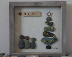 Pebble art picture family of three by christmas tree