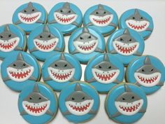 Shark decorated sugar cookies by I Am the Cookie Lady Fish Cookies, Shark Cookies, Cut Out Cookies, Shark Cupcakes, Cookie Frosting, Royal Icing Cookies, Cupcake Cookies, Shark Birthday Cakes, 10th Birthday
