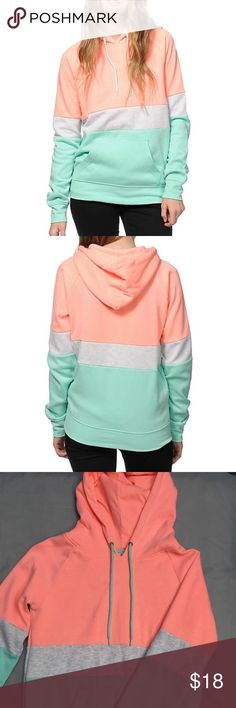 Triple block hoodie Very good condition the only flaw is that there is pilling from washing and drying it. Update your wardrobe with some bright colors thanks to this cozy pullover hoodie made with a neon coral, mint and grey colorblock design for a look that pops. Zumiez Sweaters