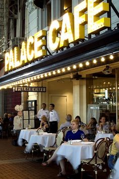 Palace Cafe in New Orleans offers great sidewalk seating.  It's on the line between the French Quarter and the business district.  New Orleans, LOUISIANA.