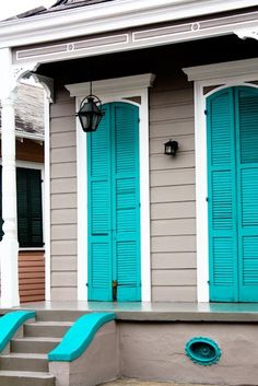 Bright turquoise blue louvered doors - Colorful home exterior - Painted front door