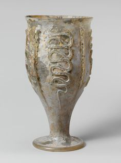 Glass beaker with snake-thread decoration. Period: Late Imperial. Date: 3rd century A.D. Culture: Roman, Rhineland. Medium: Glass; blown and trailed.
