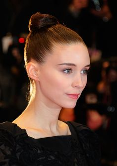 Pin for Later: 40 Topknot Looks to Top Off Your Trendy Style  You'll need a good amount of gel or pomade to get your hair to stay put à la Rooney Mara. She has no flyaways in sight.