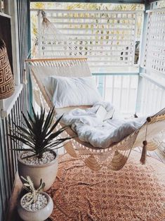 The ultimate bohemian porch goals! Visit our site for more boho decor inspiration.