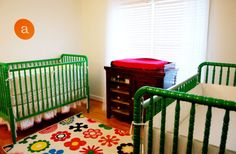 This might work... The rug is from ikea. Painted cribs with a changer in the middle.