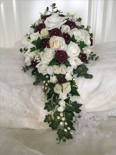 Cascading ivory cream & burgundy roses , one I made myself