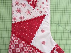 How to Make a Patchwork Christmas Stocking Use left over Xmas fabrics or fat quarters to make this stocking. Draw a stocking shape and segments onto 2 sheets. Stick the 2 sheets together. Trace on stitch & tear. Quilted Christmas Stockings, Christmas Stocking Pattern, Xmas Stockings, Christmas Sewing, Christmas Quilting, Christmas Projects, Christmas Crafts, Family Christmas Ornaments, Fabric Crafts