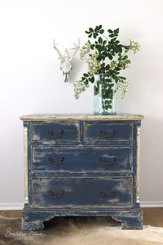 This old solid pine chest has a new look from Boulder Blue Studio. Painted in a 'shabby chic' style with layers of latex paint of indigo blue and cream accents sanded to create a distressed look. Tint
