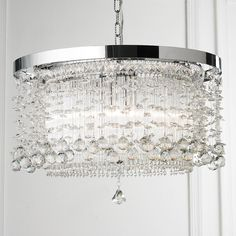 Crystals in Flight Chandelier Create a brilliant sensation with this 3 light pure lead crystal chandelier, hanging it in the foyer or pair it up over a dining table. Delicate crystal pendalogues are suspended by barely visible wires for an airy elegance.