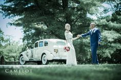 Smiling Bride and Groom with 1937 Packard super 8 limo