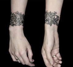 Black ink wrist cuff tatoo