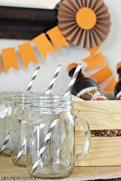 mason jars with handles and brown paper straws Create an easy A Root Beer party theme by decorating with orange and brown. #IceCreamFloat #shop #cbias