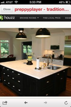 My future kitchen will be inspired by this. White cabinets with black soapstone countertops and a black island with marble countertop. Also love the subway tiles backsplash...maybe I'll do it in marble to tie it all together!!!