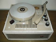 A vintage school record player is a great way to get back into or try out vinyl.  Virtually indestructible and they play 33.3, 45 and 78.  You can find them on eBay for about 60 bucks.  This one is an unusual light beige color.