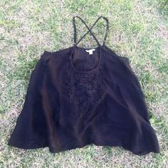 Amazing Black Guess Crop Top Gorgeous semi sheer crop top. So incredibly versatile! Adjustable straps that cross in the back. A must have for Summer ☀ My mannequin is a medium and too big for the top, so it would fit better if you are a size small. ️  100% Viscose   ❌No trades, no PayPal, no holds Instagram: @lovelionessie ⚜www.lovelionessie.com⚜ Guess Tops Crop Tops