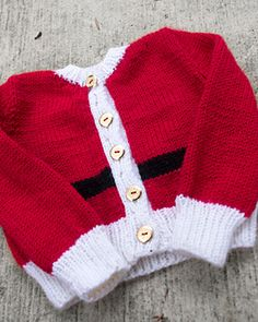 Free Christmas knitting pattern for baby, a sweet little cardigan that is very festive without being too cheesy. Knit from the bottom up and nearly seamless (the sleeves still have to be set in and the button bands sewn on, but the body is worked in one piece and the sleeves are worked in the round up to the sleeve cap) to give you a quick knitting project for that special babe before the holidays.