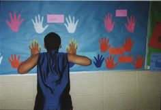 OT bulletin board in school where students can do wall pushups for self-regulation