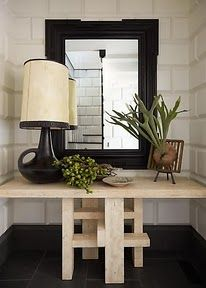 Completely fill an awkward space with a table, wallpaper or do something to the walls to make it special