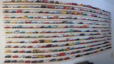 Got diecast Matchbox cars? Hot Wheels? There aren't many affordable ways to display them on your wall. So, here's what I did-- I went to Home Depot, and bought several six foot long pine boards, al...
