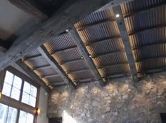 corrugated metal ceiling, wood beams, great accent lighting