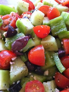 Greek Summer Salad: 2 Cucumbers (peeled/chopped), 2 pints Grape Tomatoes (sliced in half), 1 Red Pepper (chopped), 1 Green Pepper (chopped), 1/2 c. Green Onions (sliced), 1/2 c. Pitted Kalamata Olives (sliced), 1 1/2 - 2 c. Crumbled Feta Cheese, 3 T. Red Wine Vinegar, 1 T. Lemon Juice, 3 T. Olive Oil, Salt and Pepper. Directions: Combine all ingredients in a large glass, plastic or ceramic bowl -- toss to incorporate. Serve immediately, or cover and store in the refrigerator until ready to e...