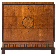 Eric Chambert, a Swedish Grace Period Marquetry and Macassar Commode | From a unique collection of antique and modern commodes and chests of drawers at https://www.1stdibs.com/furniture/storage-case-pieces/commodes-chests-of-drawers/