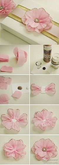 This beautiful DIY pink flower could be used in many ways for an event.  My first thought was using it in the napkin fold and/or menu placement.  The possibilities are endless, really!