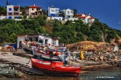A small port with fishing boats in Polydendri, Larisa, Thessaly_ Greece