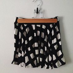 FALL SALE   Chic B&W Skater Skirt Perfect condition black and cream elastic waisted mini skirt. Super soft jersey material best fit size Small. Urban Outfitters Skirts Circle & Skater