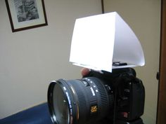 DIY in camera flash diffuser...it folds up so you can put it in your pocket and just take your camera without having to take an external flash.