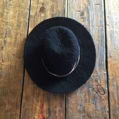 Black Wide Brimmed Hat with Leather band Black wide brimmed hat (100% polyester) with brown leather band from Urban Outfitters. Ecote Accessories Hats