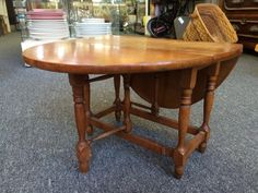 "Our ""Pick"" this week is another hard to find item. It is a very collectable, antique, maple, Gate-leg, drop-leaf table in it's original finish. The table stands 10 1/2″ high and the top measures 15 5/8″ by 21″ when fully open and 15 5/8″ by 8 1/4″ when closed. There are some rings and light stains on the top; these only add to the charm of this adorable little table. Salesman's sample furniture is a wonderful collectable for the furniture lover."