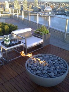 Fire pit (bowl) on a wooden deck.