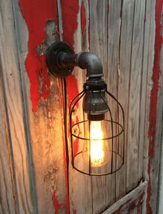 Steampunk style wall sconce creates from cast iron pipe fittings. Can be mounted up or down. Ideal in an industrial environment , factory, loft , bar decor , restaurant , medical office or just a room. Sold with an Edison bulb. Like all our steampunk style lamps , the luminaire is made to order for each customer. The turnaround time is 2 to 3 weeks.