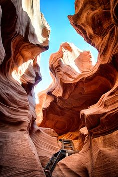 Antelope Canyon, Arizona- After you squeeze into the canyon you're met with a metal ladder to help you get to the bottom. Before the ladder was installed travelers had to rappel to the bottom, and there wouldn't be any way to get out of the canyon at the opposite end without a ladder. Photo by Travis Burke.