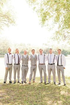 Suspenders, white shirts, & grey slacks..  Read More: http://www.stylemepretty.com/2014/04/22/rustic-southern-plantation-wedding/