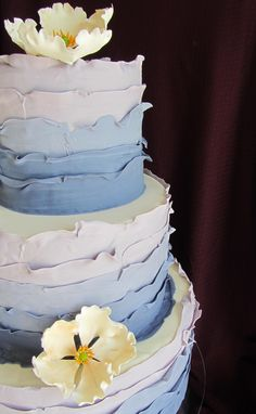 Ombre wedding cake with ruffles and sugar flowers.