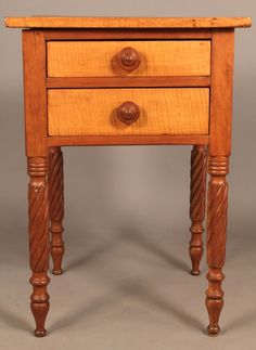 "Maple and cherry two drawer stand on rope legs. The top and drawer fronts are maple, the rest of exterior is cherry, with poplar secondary wood. Dovetailed drawers with old wooden pulls. 28 1/4"" H x 20 1/4"" W x 19 3/4"" D. Southern, possibly Kentucky, circa 1840."