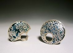 """Blue and white"" by Heng Lee. 2011.Silver, enamel. Jewellry with traditional Chinese pattern and culture."