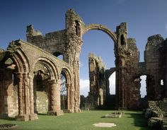 View of the nave in the priory church at Lindisfarne Priory (England) with decorated pillars