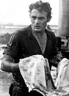 "James Dean cleans up after filming the oil scene in ""Giant"", (1956)."
