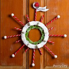 Candy-cane you dig this rad Christmas wreath? This funky starbust is made of gumballs and peppermint candy sticks glued to a foam craft wreath. Click for how-to tips and more ideas for DIY Christmas wreaths!