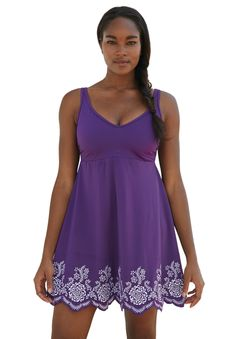 """Feminine plus size swimdress with a border of elegant embroidery around the hem.  in a fit-and-flare silhouette with anempire waist  skirt is 27"""" long from center front soft cup bra for shape and support  attached panty for a smooth fit soft nylon/spandex blend hand wash; imported  Swimming suits plus size in sizes 12, 14, 16, 18, 20, 22, 24, 26  Fit and Fashion Notes: Designed in an A-line fit that creates an elegant silhouette, this plus size swim dress is ready to stay ..."""