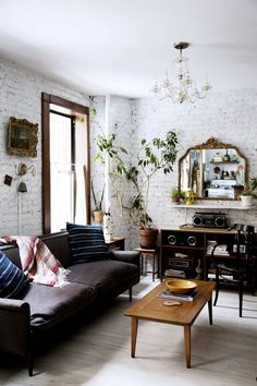 Eclectic apartment living room design with exposed brick walls