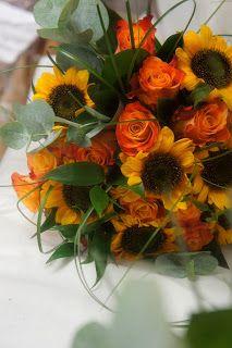 bouquet di girasoli e rose arancio