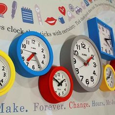 Jones Clocks, Mini Electric, Fab and Bond Clocks in yellow, blue, grey, and red.