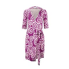 Famous for her slinky wrap dresses, Diane von Furstenberg understands the female form. This wrap dress is designed with swirl prints and a tie front closure. Material is composed of 100% silk. Please note that there is some discolouration/staining from the purple portion of dress.