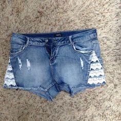 Light Jean shorts with lace on sides, darling Absolutely the cutest shorts, with peekaboo lace,on each side layered and distressed., wore twice and washed, just too short for me Rue 21 Shorts Jean Shorts